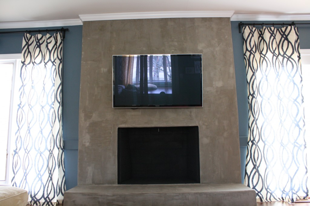 DIY Concrete Fireplace tutorial.  Learn how to create your own DIY Fireplace with Ardex Feather Finish!  By Designer Trapped in a Lawyer's Body {www.designertrapped.com}