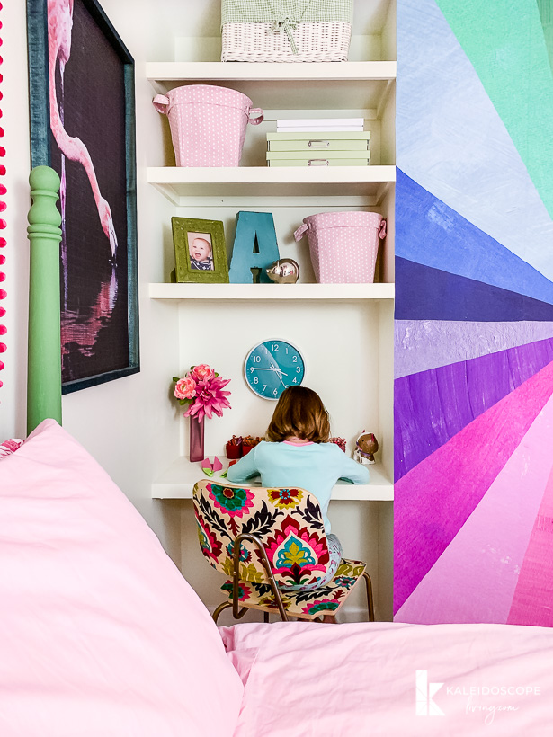 floating shelves and desk in colorful room