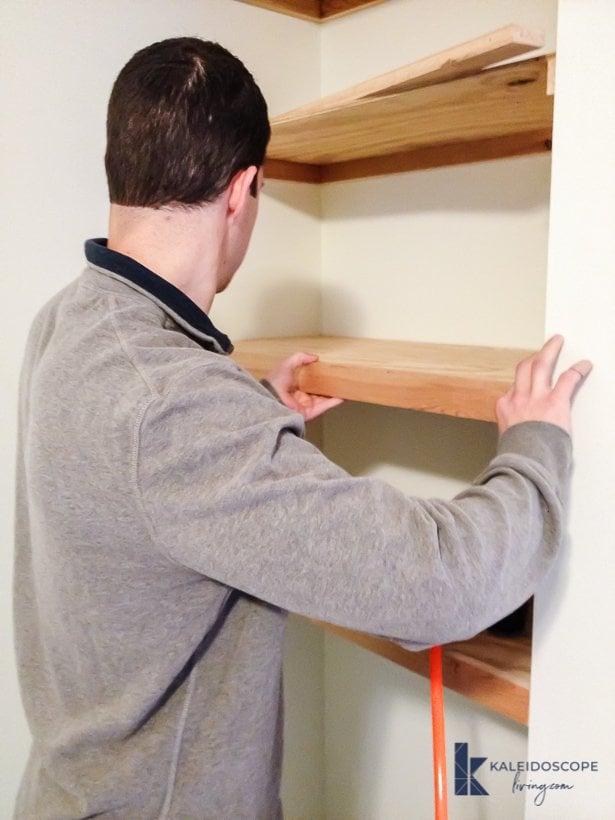 DIY floating shelves being installed