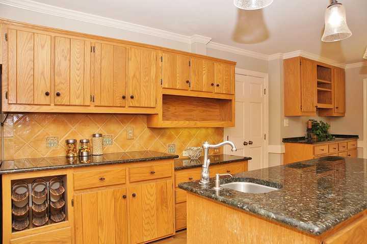 orange oak cabinets