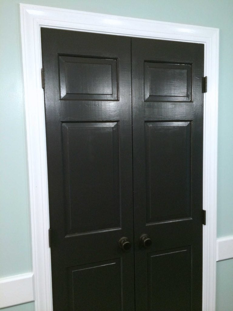 Black doors with white trim can make a HUGE impact!  Full details by Designer Trapped in a Lawyer's Body {www.designertrapped.com}