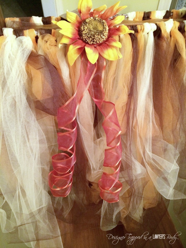 attaching sunflower to scarecrow tutu