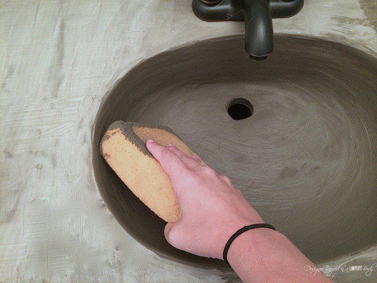 sponge and concrete on sink