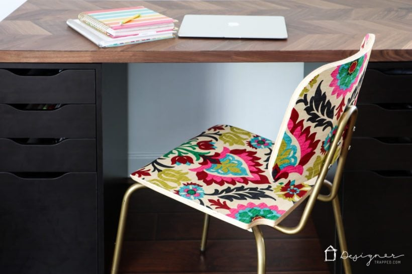 "Did you know you can decoupage furniture to get an ""upholstered"" look on a tiny budget? Come check out how to ""upholster"" a chair with Mod Podge and fabric!"