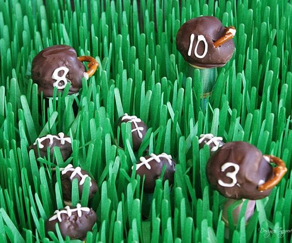 OMG! These OREO cookie balls in the shape of footballs and helmets are SO CUTE! Full tutorial by Designer Trapped in a Lawyer's Body. #OREOCookieBalls #Ad