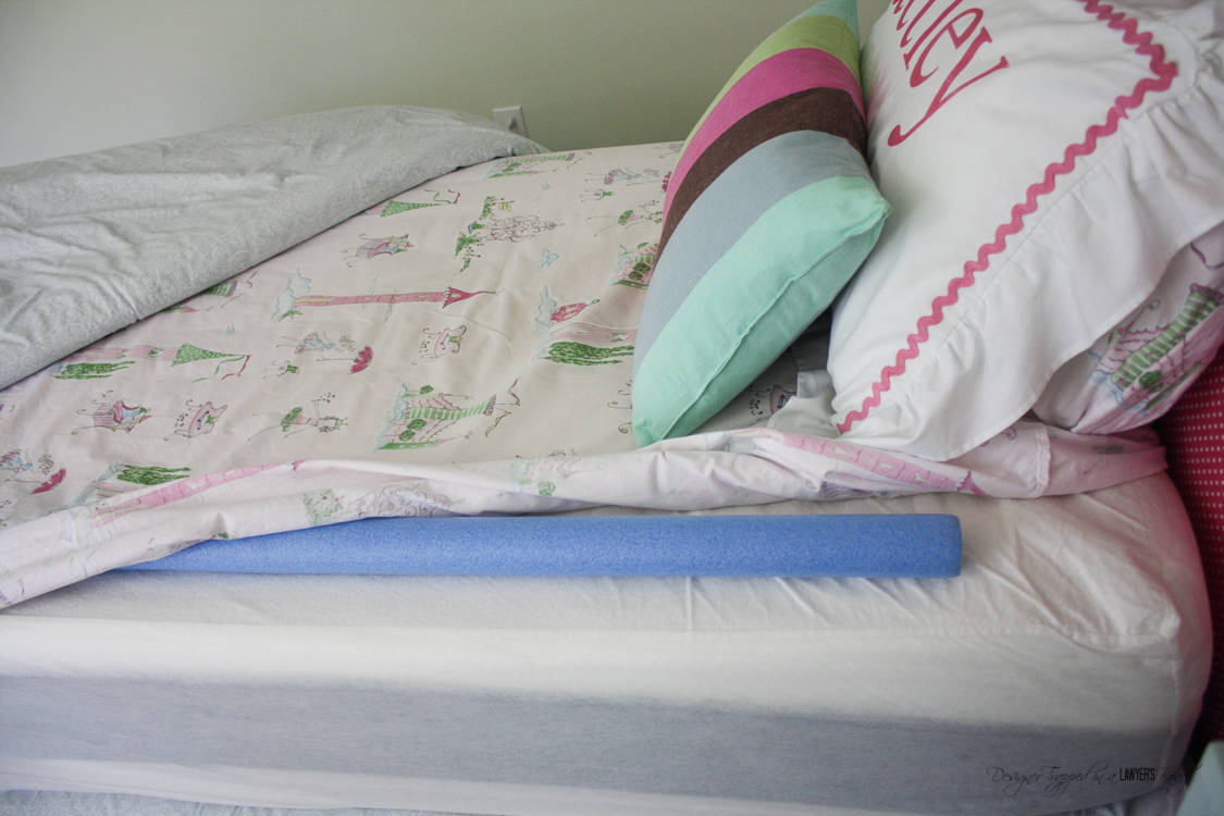 This is GENIUS! Keep your kids in bed with these DIY bed rails using inexpensive pool noodles! Plus, learn the secret to what to put in them to make your kids sleep better than ever before! Full details from Designer Trapped in a Lawyer's Body.