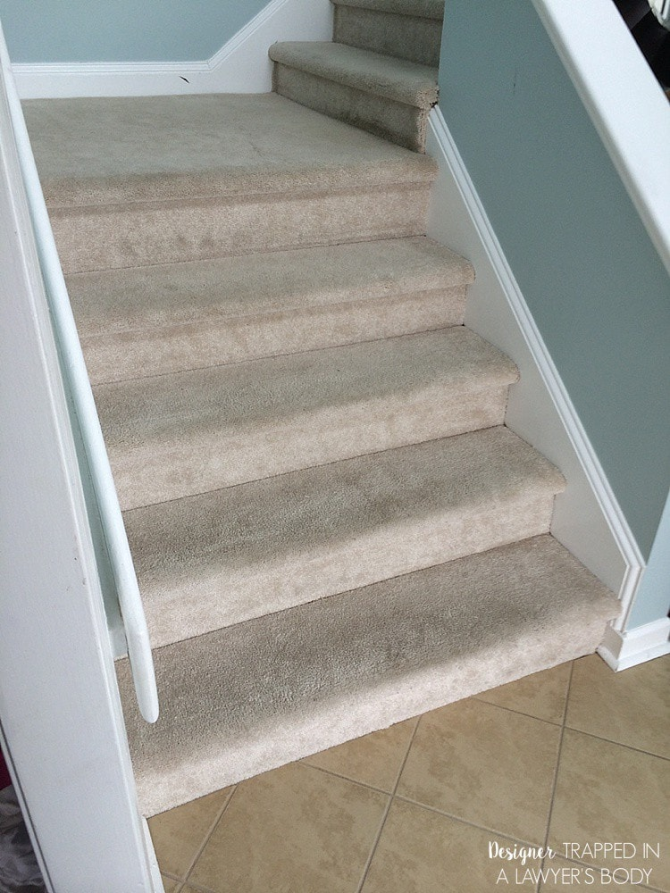 Carpeted stairs before DIY staircase makeover