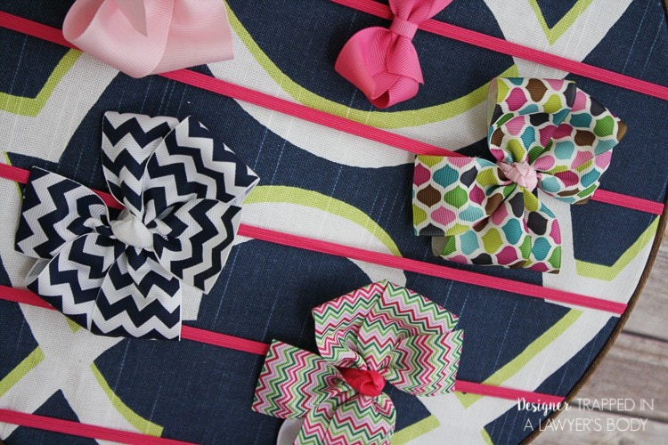 THIS IS FABULOUS! This simple, easy DIY hair bow holder is the perfect solution to organizing your little girl's hair bows! Full tutorial by Designer Trapped in a Lawyer's Body.