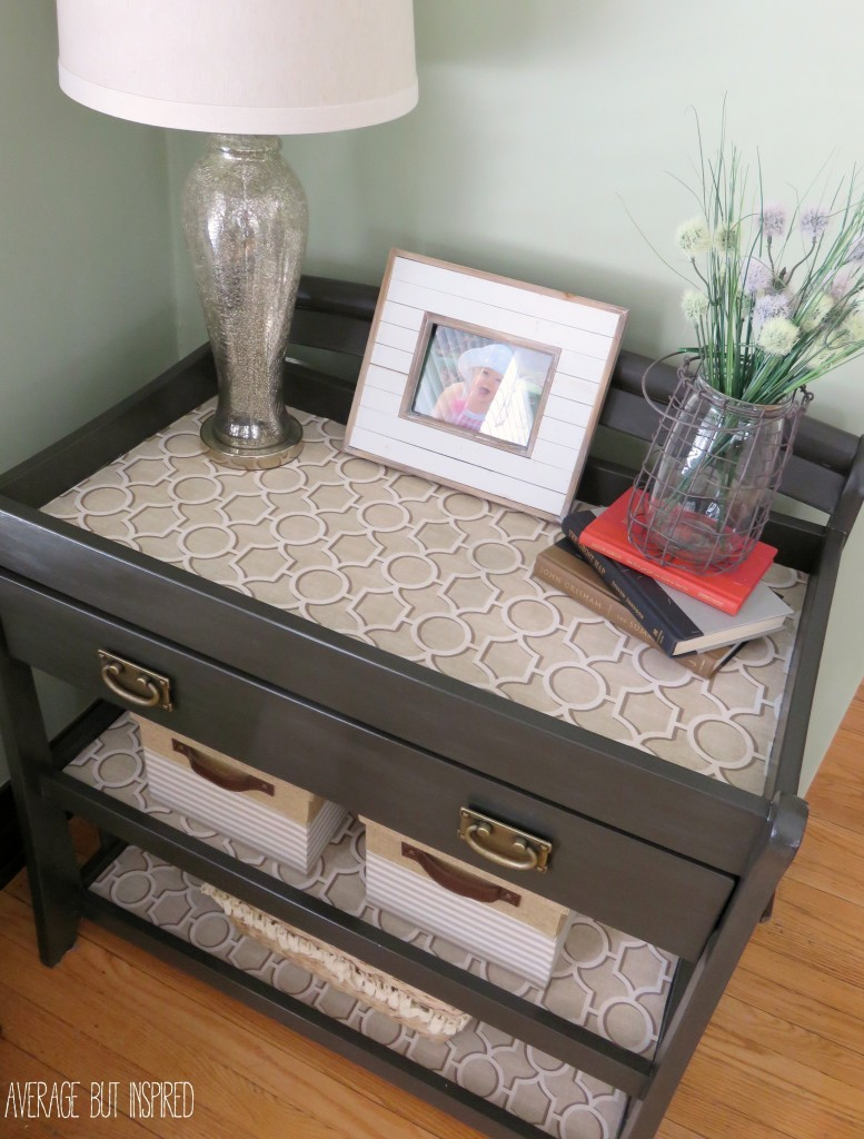 Learn how to upcycle a changing table into a chic console table with paint and fabric!