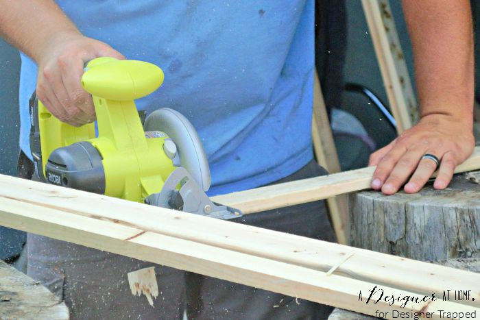 circular saw cutting reclaimed wood from a box spring A Designer At Home for Designer Trapped
