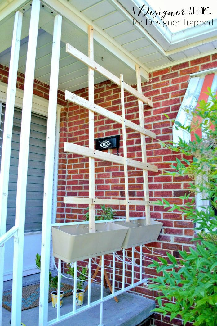 dressing up the front porch by adding window boxes to porch railing and lattice in progress A Designer At Home for Designer Trapped