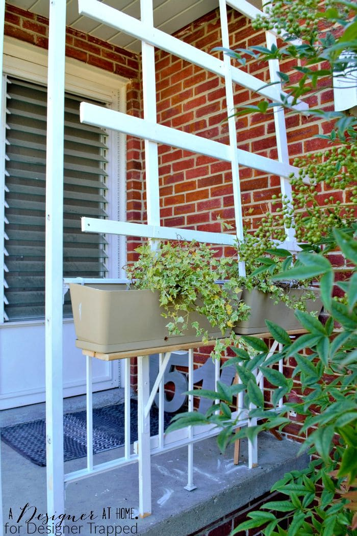 front porch refresh with DIY reclaimed wood porch planter stand and lattice A Designer At Home for Designer Trapped