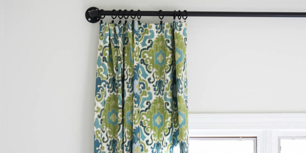 YES! This is an awesome post on how to make curtains the easy way! Full tutorial by Designer Trapped in a Lawyer's Body.