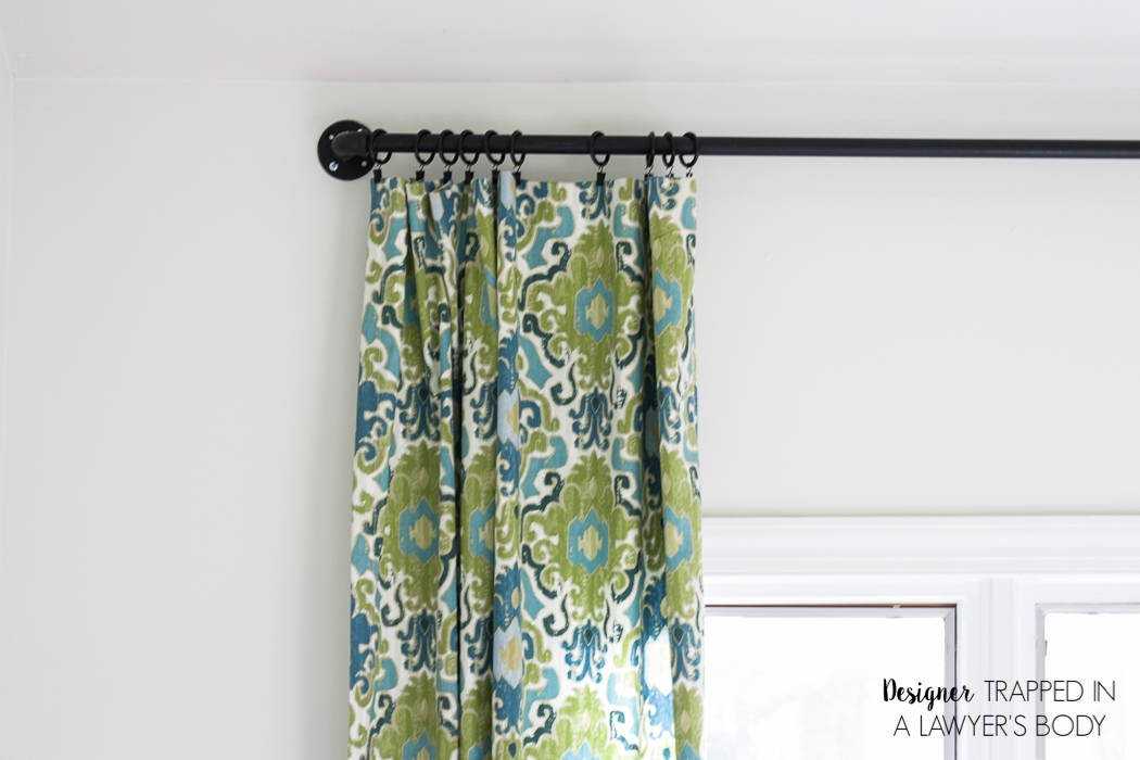 9) I made some DIY curtains with a fabric that I saw in a store and fell in love with.   They were easy to make and are perfect for the space.
