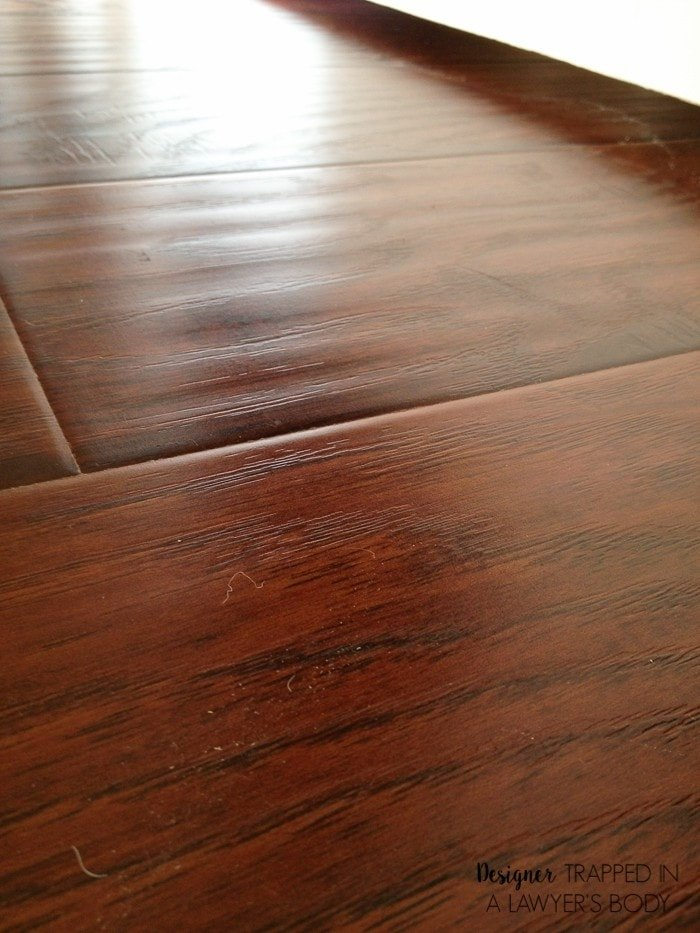 Laminate flooring has come a LONG way, y'all! Learn why I chose laminate flooring for our home!