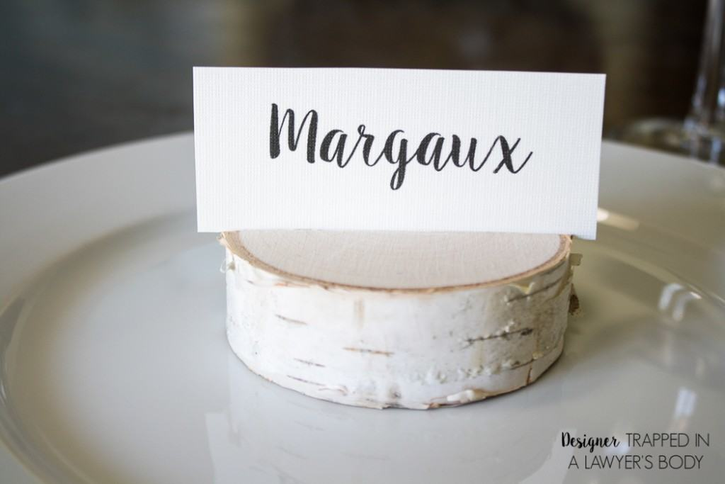 LOVE THESE! Make your own DIY place card holders using wood slices. It takes about 30 seconds per place card holder. Full tutorial from Designer Trapped in a Lawyer's Body.