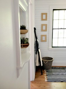 Amazing Minimal Hallway Makeover with Gold Studded Plank Walls by Houseologie