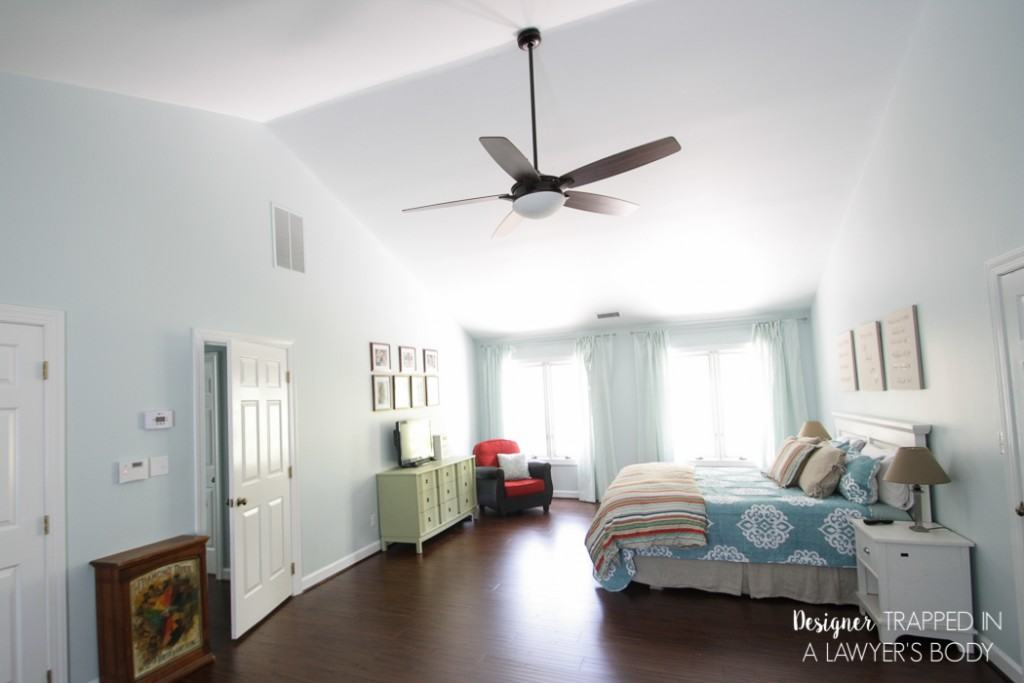 WOW! Never underestimate the power of some paint and new flooring! This room was totally transformed with those two elements. Come learn more about master bedroom decor ideas at Designer Trapped in a Lawyer's Body.