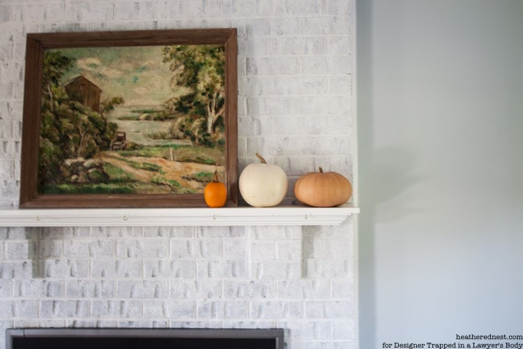 WOW! Come learn how to paint a brick fireplace with this full tutorial. It's EASY, INEXPENSIVE, and makes a BIG IMPACT! Full tutorial by The Heathered Nest for Designer Trapped in a Lawyer's Body.
