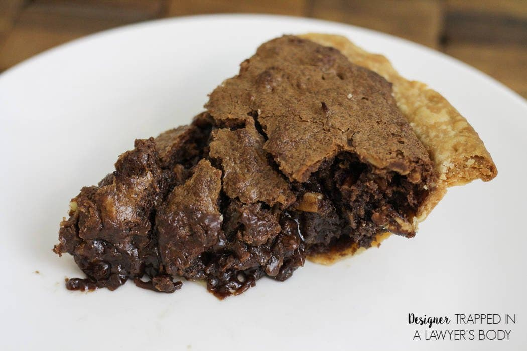 YUM! This German Chocolate Pie is one of the best desserts you will ever taste! It's crisp on the outside and gooey in the middle! It's the perfect pie for Thanksgiving and all occasions! #spon