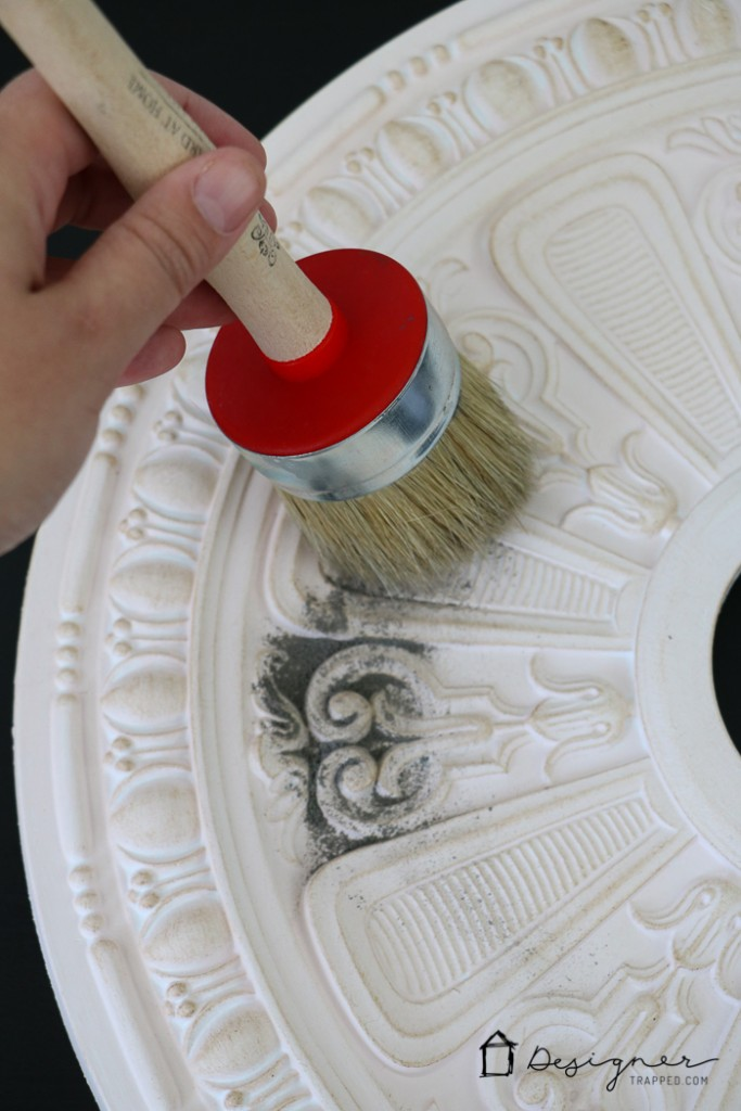 GENIUS! Deal with that unsightly ring left by flush mount light fixtures by customizing your own DIY ceiling medallion. Full tutorial from Designer Trapped in a Lawyer's Body.