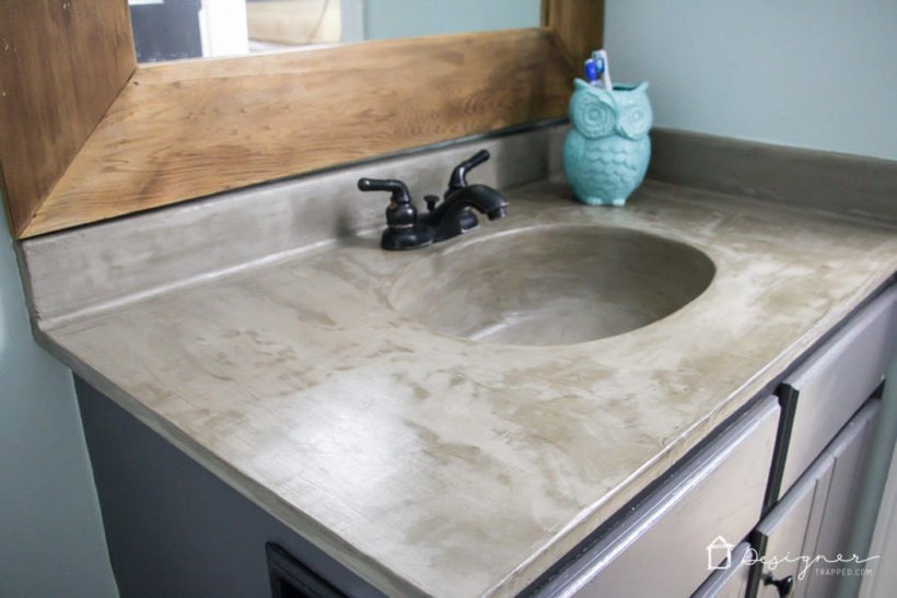 Learn how our DIY concrete vanity is holding up 18 months after completion! / DIY concrete counter top / DIY concrete sink / designertrapped.com