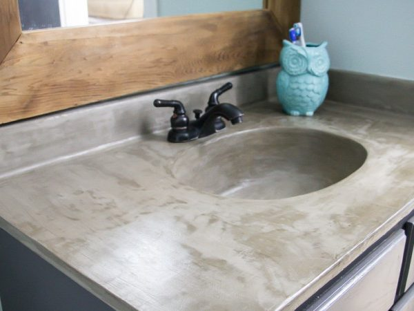 You can update your bathroom vanity without spending a fortune! This DIY vanity update using a concrete overlay with Ardex Feather Finish can be done for around $50 (including a new faucet). Check out the full tutorial!