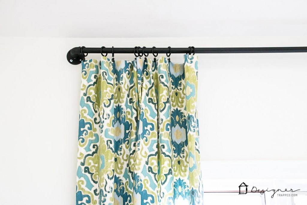 Wow! This blogger shows you how easy it is to make a gorgeous DIY curtain rod out of pipe in less than 10 minutes! | DIY curtain rod from pipe | designertrapped.com