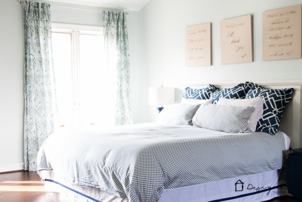 DIY bedroom decorating ideas! Never underestimate how much fresh new bedding can transform a room! LOVE this navy and white bedding. The mix of patterns is so pretty!