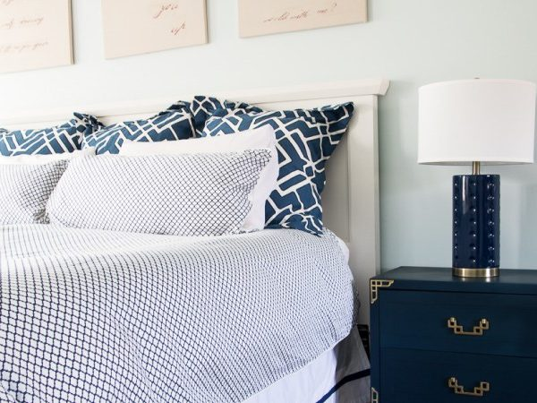 Love this navy and white master bedroom! The mixture of patterns is gorgeous!
