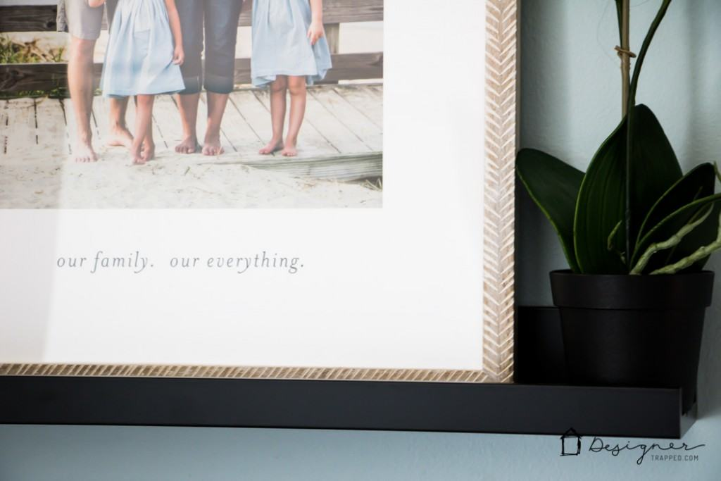 Create a hallway with PERSONALITY on a budget with DIY photo canvases and inexpensive photo ledges, coupled with some personalized art pieces. Love this!