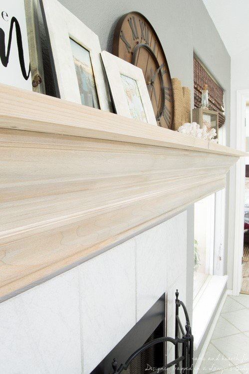Wow! Check out this DIY fireplace mantel update made from simple molding. Love the driftwood finish!