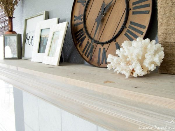Wow!! Check out this DIY mantel update with crown molding and given a beautiful driftwood finish!