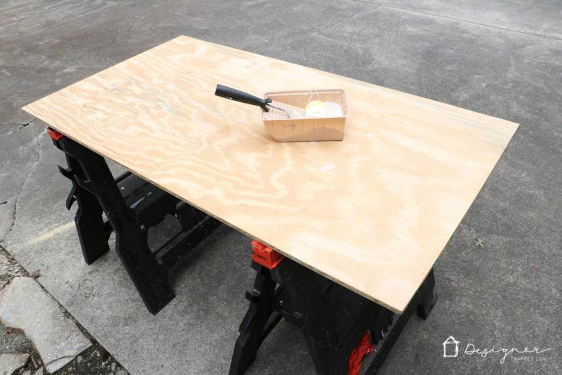plywood with paint roller