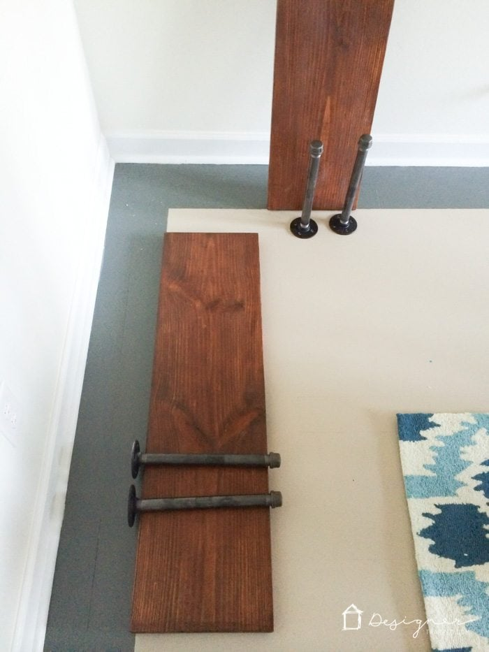 OMG, I LOVE these DIY pipe shelves and cannot believe how easy they are to make. Industrial shelves are so my style. I never realized how easy and affordable it is to make DIY pipe shelves. Adding it to my to do list!