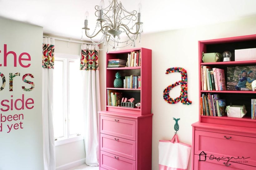 girls bedroom with pink bookcases