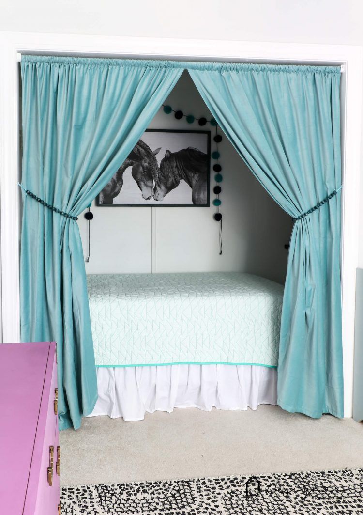OMG, what kid wouldn't love this cozy bed nook?! Learn all about how to turn a closet into a bed nook by clicking through to the post. Spackling tips included :)