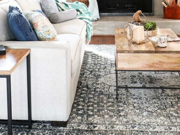 This living room rug placement is perfect for the size of the furniture and space it's placed!