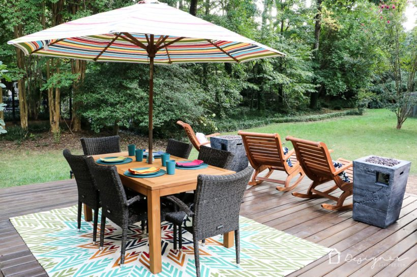 backyard deck with teak and acacia furniture
