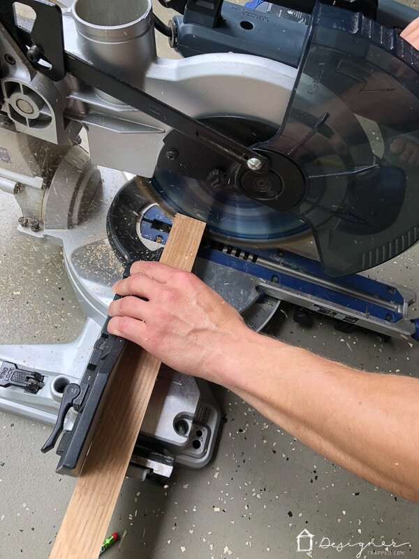 compound miter saw cutting 2 x 2