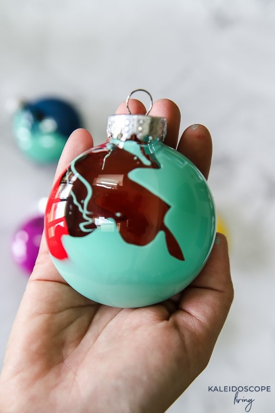 turquoise and red painted ornament