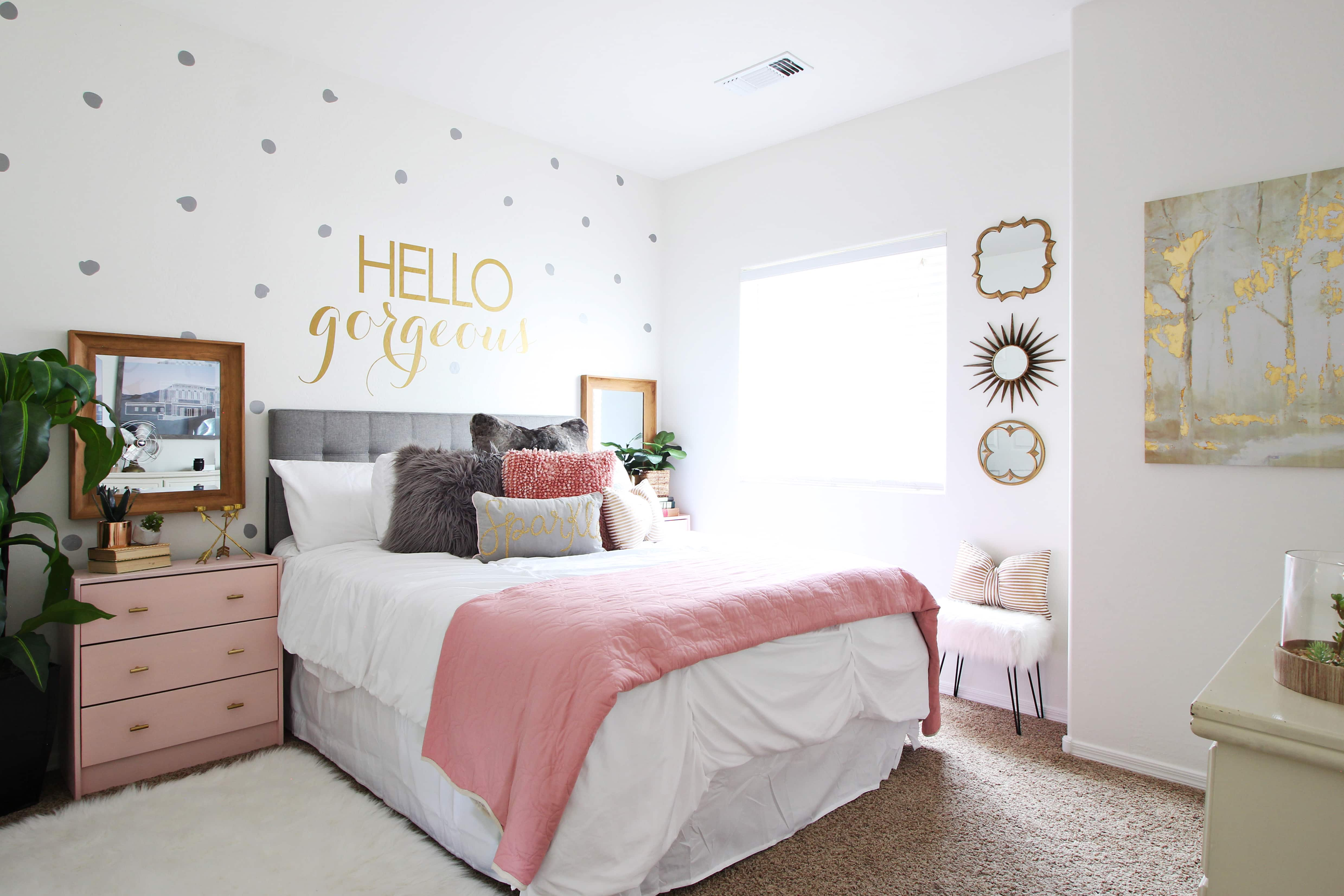pink and grey girl room with mixed metals