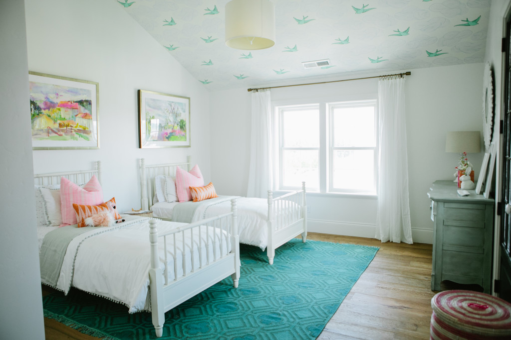 wallpapered ceiling in simple girl room