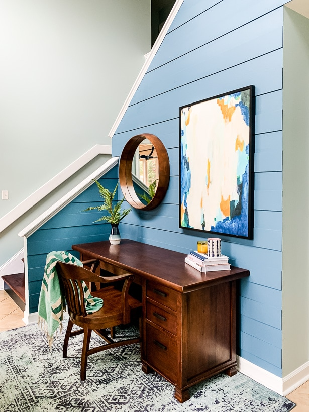 wood desk in entryway by stairs