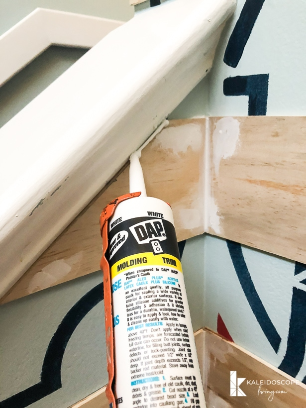 caulking a plank wall