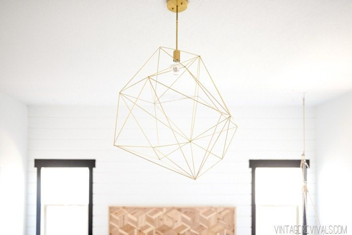Giant geometric brass light fixture