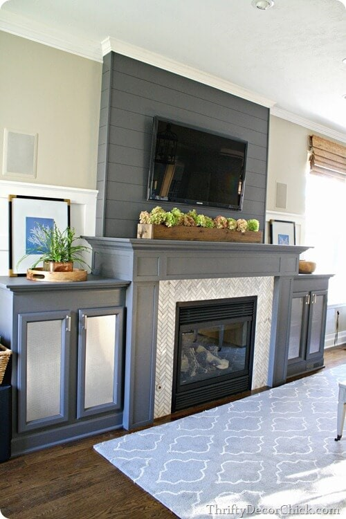 grey fireplace makeover with herringbone tile