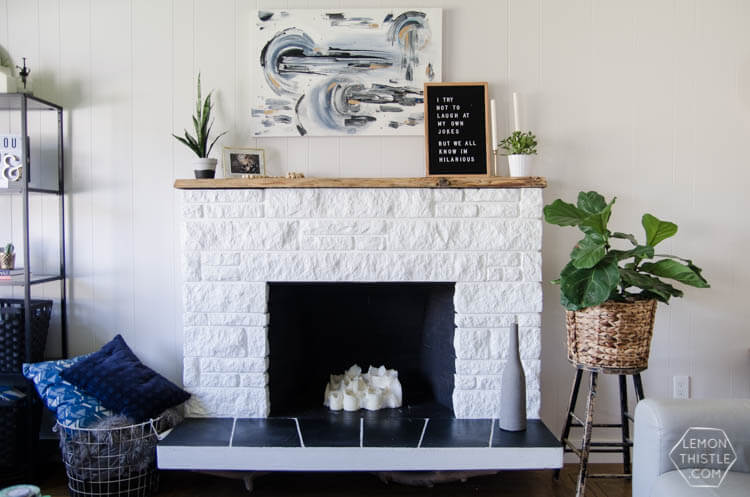 brick fireplace with live edge mantel