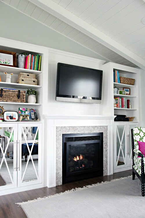 DIY builtins and tile work around fireplace