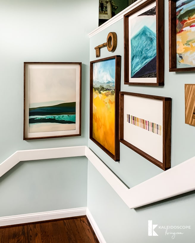 stairs with large DIY art frames